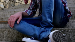 Depressed teenager boy sitting on stairs. Depression concept Stock Footage