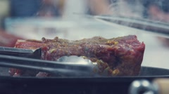 A piece of meat overturn a special shovel. Cooking roast beef Stock Footage