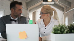 Happy coworkers talking in the office Stock Footage