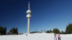 View of Snezhanka Peak with skiers and Tv tower on background Stock Footage
