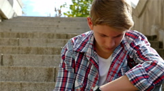Depressed teenager boy sitting on stairs, male hand helping him standing Stock Footage