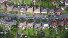 Titling aerial view of houses and gardens. Stock Footage