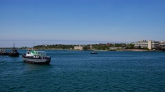 The boat with the sailors go on a warship. Sevastopol. Crimea. Stock Footage