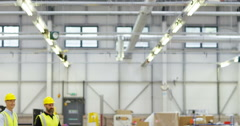 4K Cheerful group of workers in modern factory walking through the building  Stock Footage