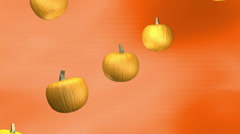 Subtle orange background with falling pumpkins loop Stock Footage
