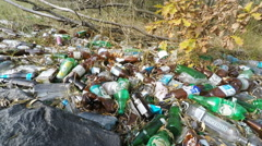 Pile of empty beer and alcohol bottles near Chernobyl muclear power plant Stock Footage