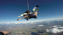 Skydiving tandem jump friends Stock Footage