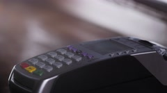 Customer paying with NFC technology by mobile phone on terminal in modern cafe Stock Footage