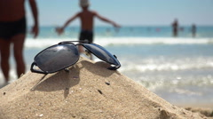 Sunglasses on the tropical beach. Travel relax vacation Stock Footage