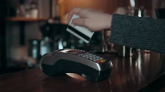 Close up of hands with credit card reader at modern cafe Stock Footage