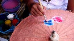 Yong girl painting on Handmade umbrella. Stock Footage