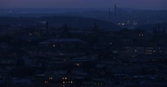 A panoramic view of Prague buildings illuminated windows, roofs, hills and tr Stock Footage