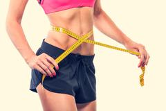 Weight losing - measuring woman's body Stock Photos