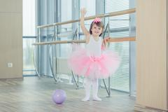 Adorable child dancing classical ballet in studio Stock Photos