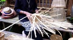 Weaving bamboo basket. Stock Footage