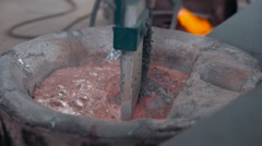 Molten metal cleaning by mixer molding and aluminum alloy casting, red hot iron Stock Footage