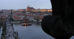The Charles Bridge with tourists walking along, it's western tower and a boat Stock Footage