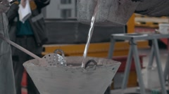 Molten metal poured in sand molding and aluminum alloy casting, red hot metal Stock Footage