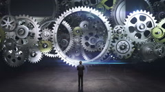 Businessman standing big Gear wheels, connecting gear wheels.1. Stock Footage
