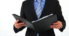Mid-section of businessman holding file folder and checking time Stock Footage