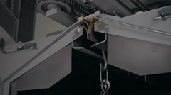 Metal detail on Electrical small crane on modern factory Stock Footage