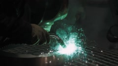 Welder Industrial automotive part in factory, hot metal welding on modern Stock Footage