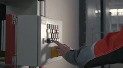 Operator controls the modern cnc machining center. Selective focus on hand Stock Footage