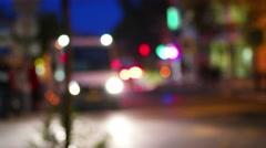 Night City Scene. Publick transportation people get in small bus defocused shot Stock Footage
