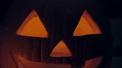 Glowing Candle Illuminates a Spooky Jack o'lantern Pumpkin Stock Footage