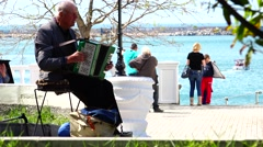 Old man war veteran played the accordion at the pier of Sevastopol. Crimea. Stock Footage