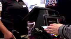 Motion of people buying ice cream at mcdonalds check out counter Stock Footage
