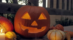 A Candle Flickers Inside a Halloween Jack O'Lantern Stock Footage