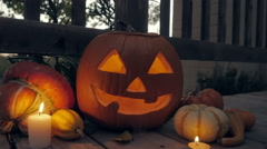 Autumnal Gourds Surround a Lit Jack o'Lantern Stock Footage
