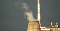 Pollution concept. Smoke or steam discharged from an big industrial chimney Stock Footage