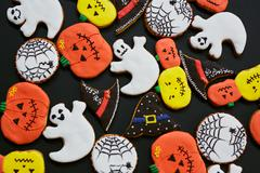 Tasty biscuits in shape of Halloween attributes Stock Photos