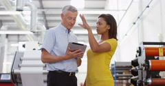 4K Business managers in factory looking at tablet & discussing operations Stock Footage