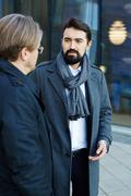 Well-dressed entrepreneur talking to colleague Stock Photos