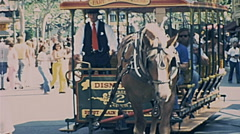 Disneyland 1977: horse carriage with visitors Stock Footage