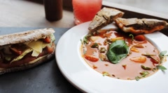 Gazpacho soup, salads and drink at restaurant Stock Footage