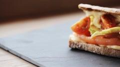 Salmon panini sandwich on stone plate Stock Footage