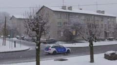 Falling snow at appartment blocks in a city. Slow motion footage. Stock Footage