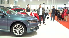 Car exhibition - parked cars and people walking and watching cars - interior Stock Footage