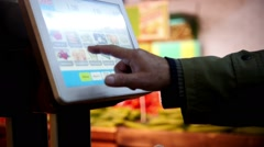 Electronic scales in the supermarket, customer weighs the purchase in vegetable Stock Footage