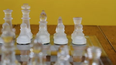 Glass Chess Pieces Set Up On Board Stock Footage