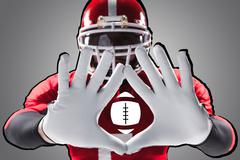 The hands of american football player on white Kuvituskuvat