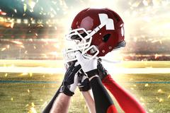 The hands of american football players with helmet on white background Kuvituskuvat