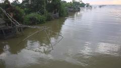 Thai style fishing trap in Pak Pra Village at sunrise Stock Footage