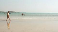 Unidentified man walking on the Palolem beach Stock Footage
