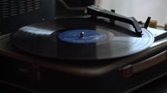 Low angle view of old fashioned turntable playing a track from black vinyl. Stock Footage
