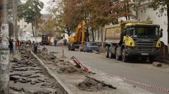 Road works digging up street sidewalök pavement in Kiev, Ukraine Stock Footage